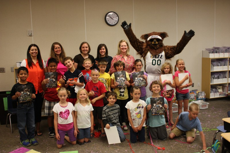 Group of k-2nd graders with the Jazz Bear