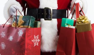 Santa Claus holding bags full of presents