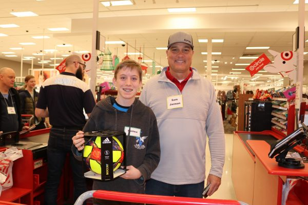 Superintendent and student standing in Target with a shopping cart